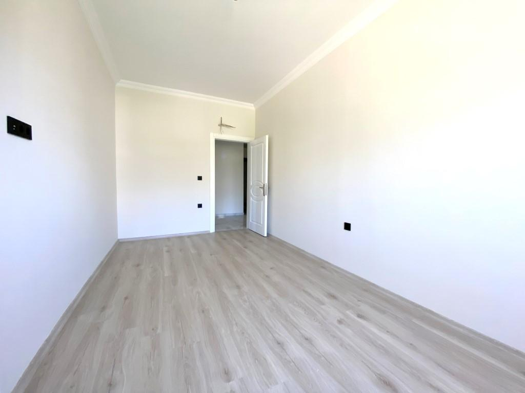Новые светлые апартаменты 3+1 с панорамным видом в Махмутлар - Фото 16