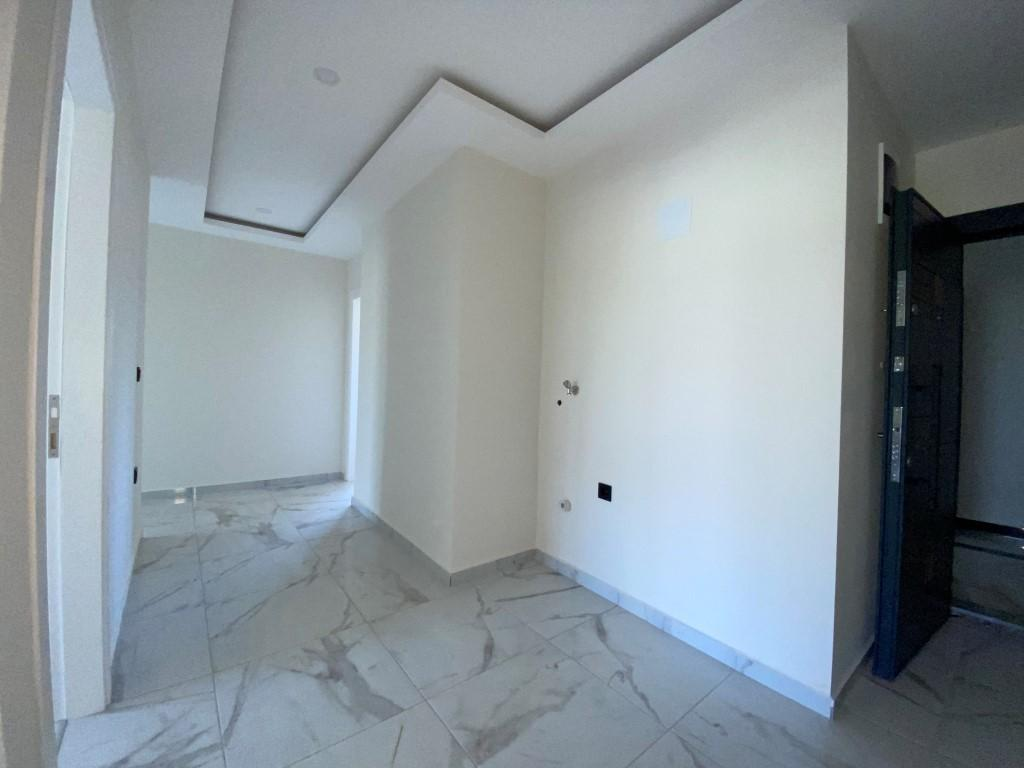 Новые светлые апартаменты 3+1 с панорамным видом в Махмутлар - Фото 18