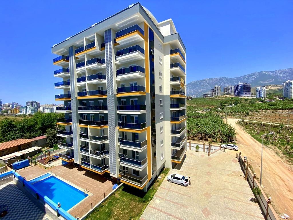 Новые светлые апартаменты 3+1 с панорамным видом в Махмутлар - Фото 3