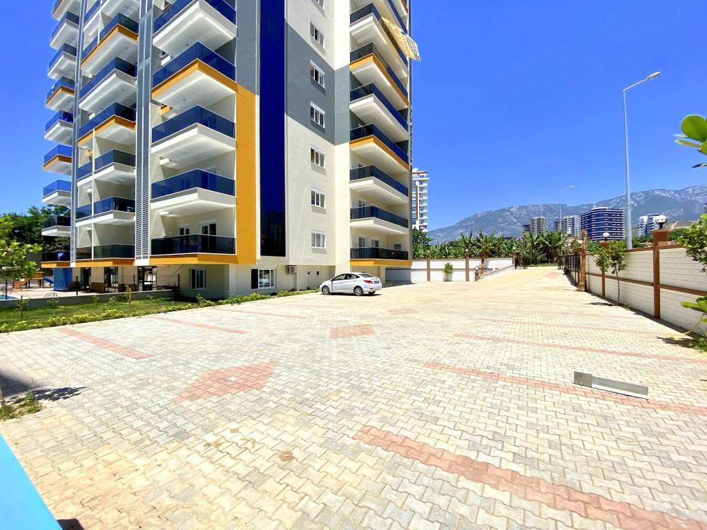 Новые светлые апартаменты 3+1 с панорамным видом в Махмутлар - Фото 4