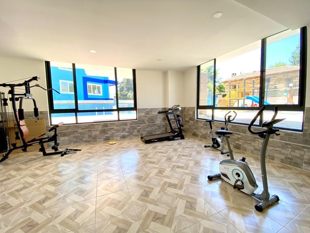 Новые светлые апартаменты 3+1 с панорамным видом в Махмутлар - Фото 7