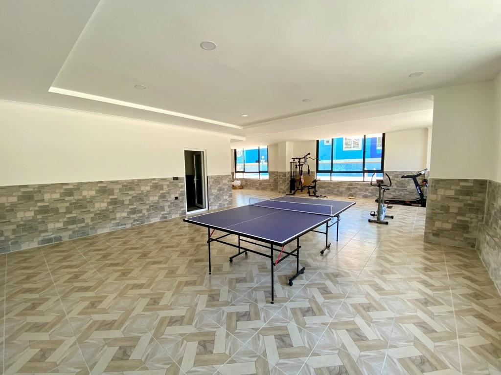 Новые светлые апартаменты 3+1 с панорамным видом в Махмутлар - Фото 8