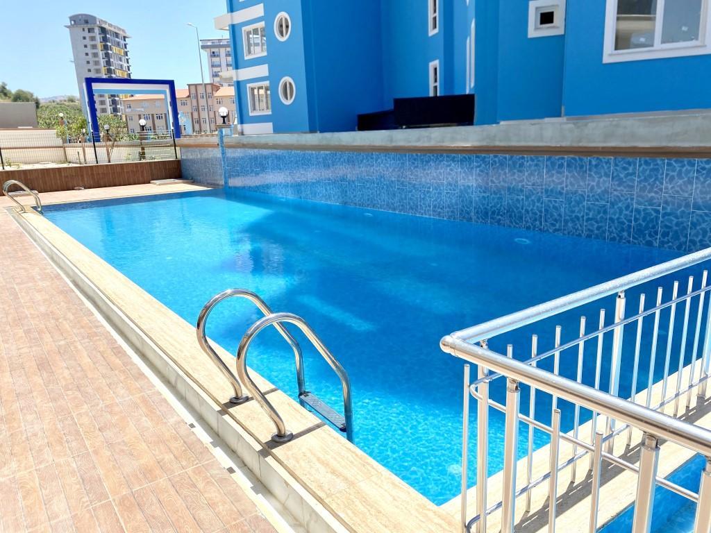 Новые светлые апартаменты 3+1 с панорамным видом в Махмутлар - Фото 6