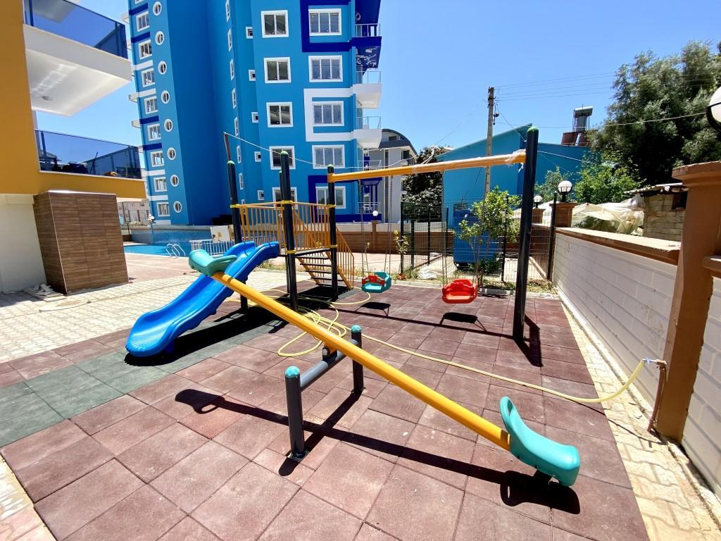 Новые светлые апартаменты 3+1 с панорамным видом в Махмутлар - Фото 11