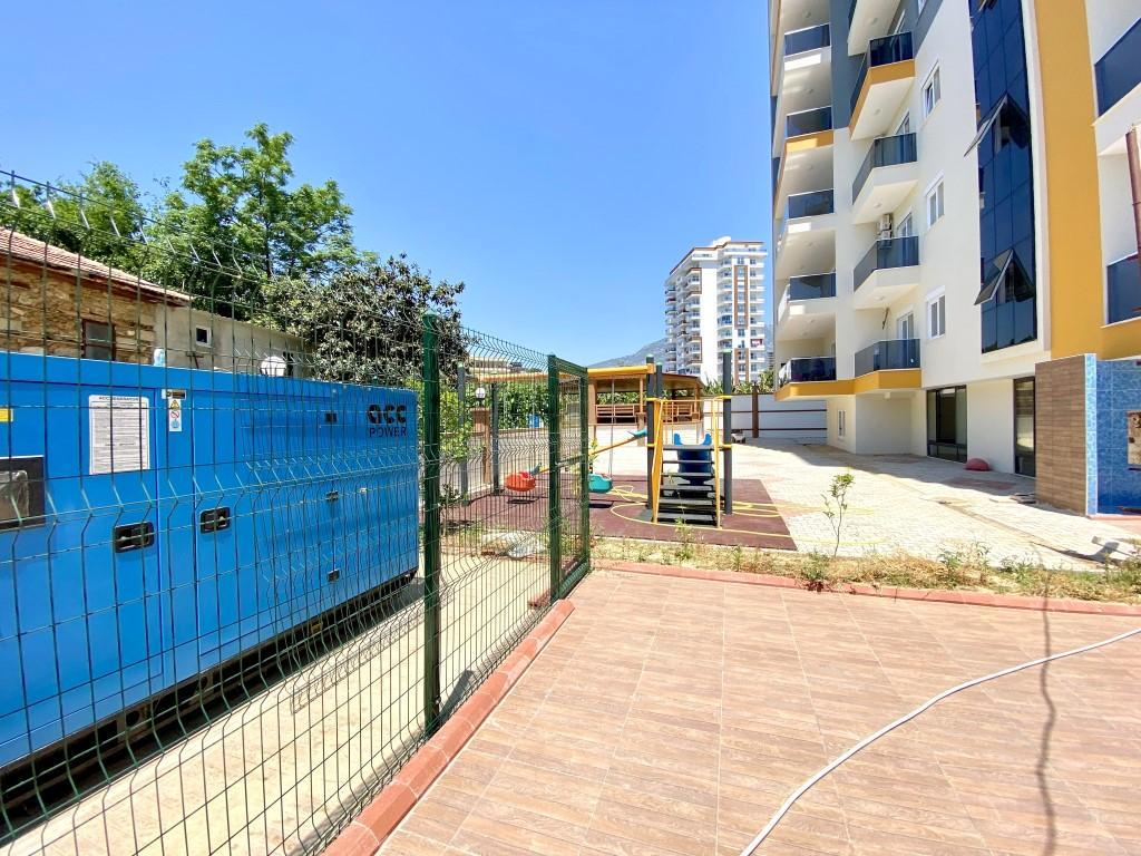 Новые светлые апартаменты 3+1 с панорамным видом в Махмутлар - Фото 12