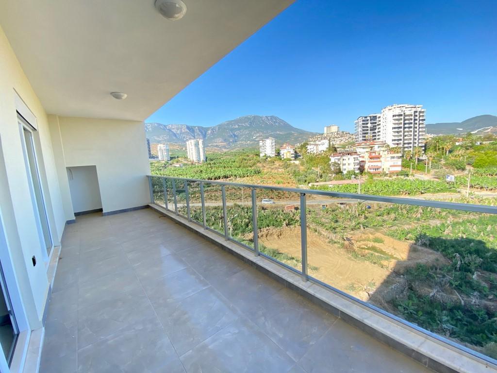 Новые просторные апартаменты 3+1 с панорамным видом в Махмутлар - Фото 2