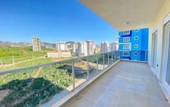 Новые просторные апартаменты 3+1 с панорамным видом в Махмутлар