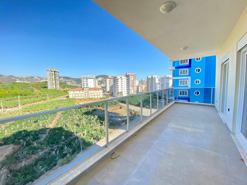 Новые просторные апартаменты 3+1 с панорамным видом в Махмутлар - Фото 1