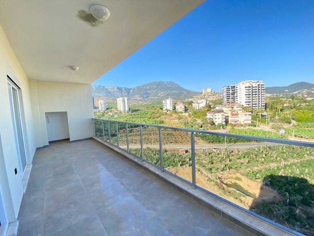 Новые светлые апартаменты 3+1 с панорамным видом в Махмутлар - Фото 1