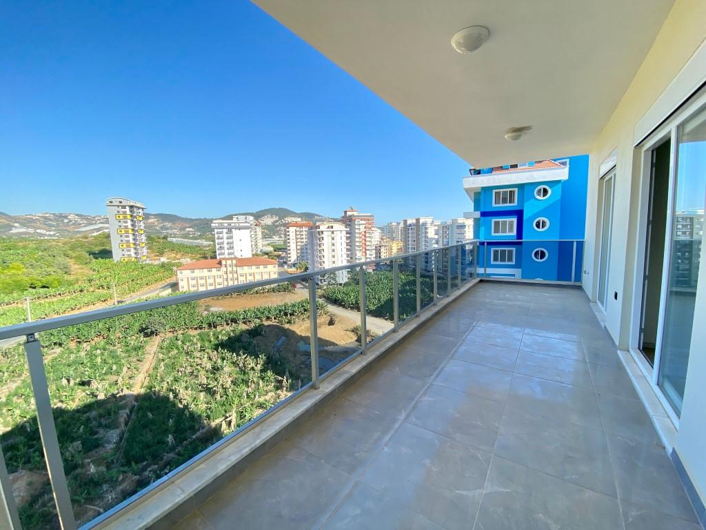 Новые светлые апартаменты 3+1 с панорамным видом в Махмутлар - Фото 2