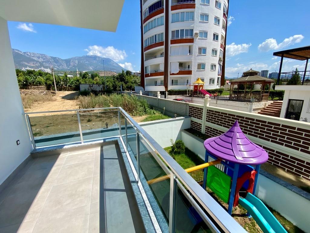 Новая квартира 1+1 в уютном комплексе в Махмутларе - Фото 21