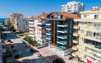 Меблированные апартаменты 2+1 в районе Махмутлар с эксклюзивным дизайном