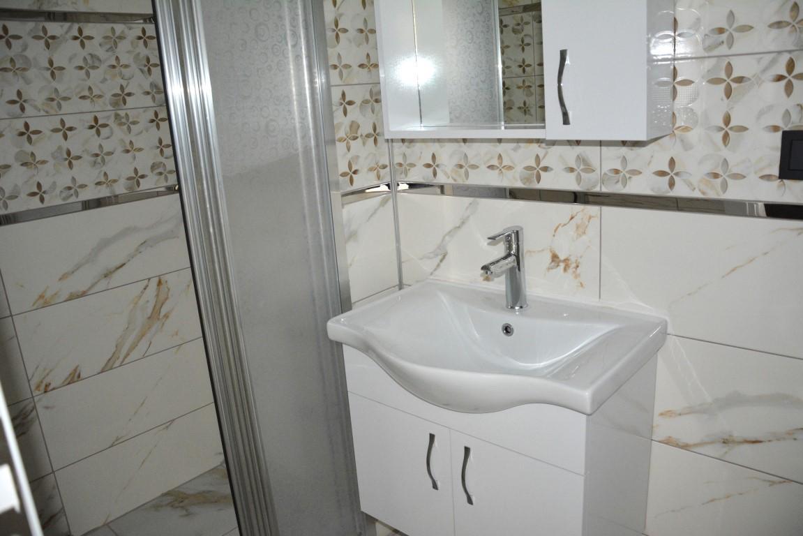 Новые светлые апартаменты 3+1 с панорамным видом в Махмутлар - Фото 24