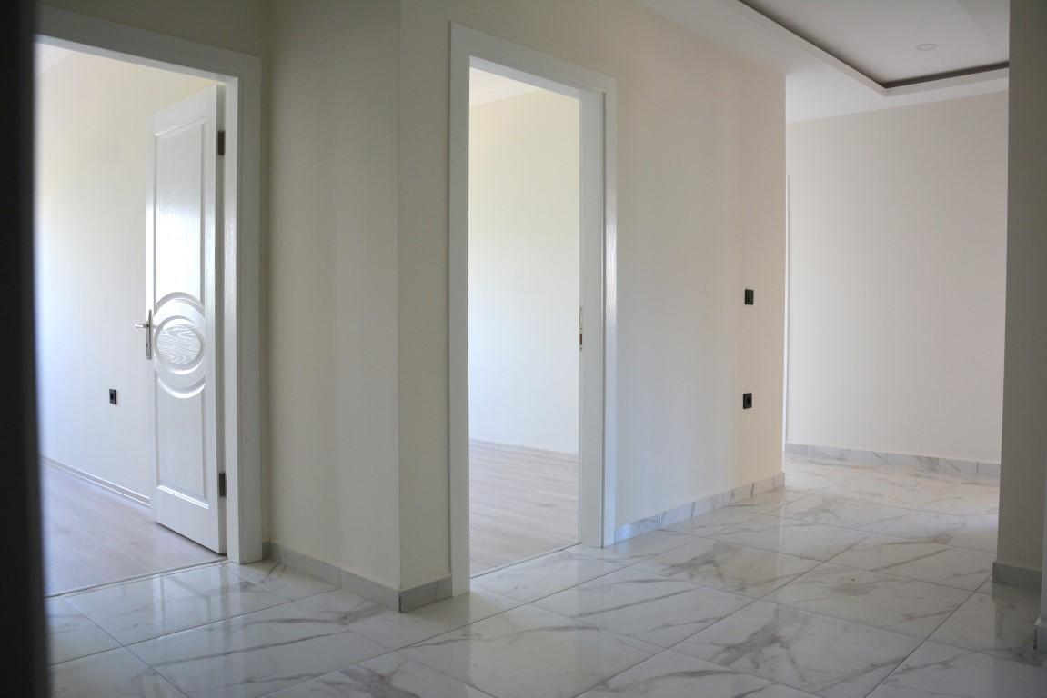Новые просторные апартаменты 3+1 с панорамным видом в Махмутлар - Фото 24