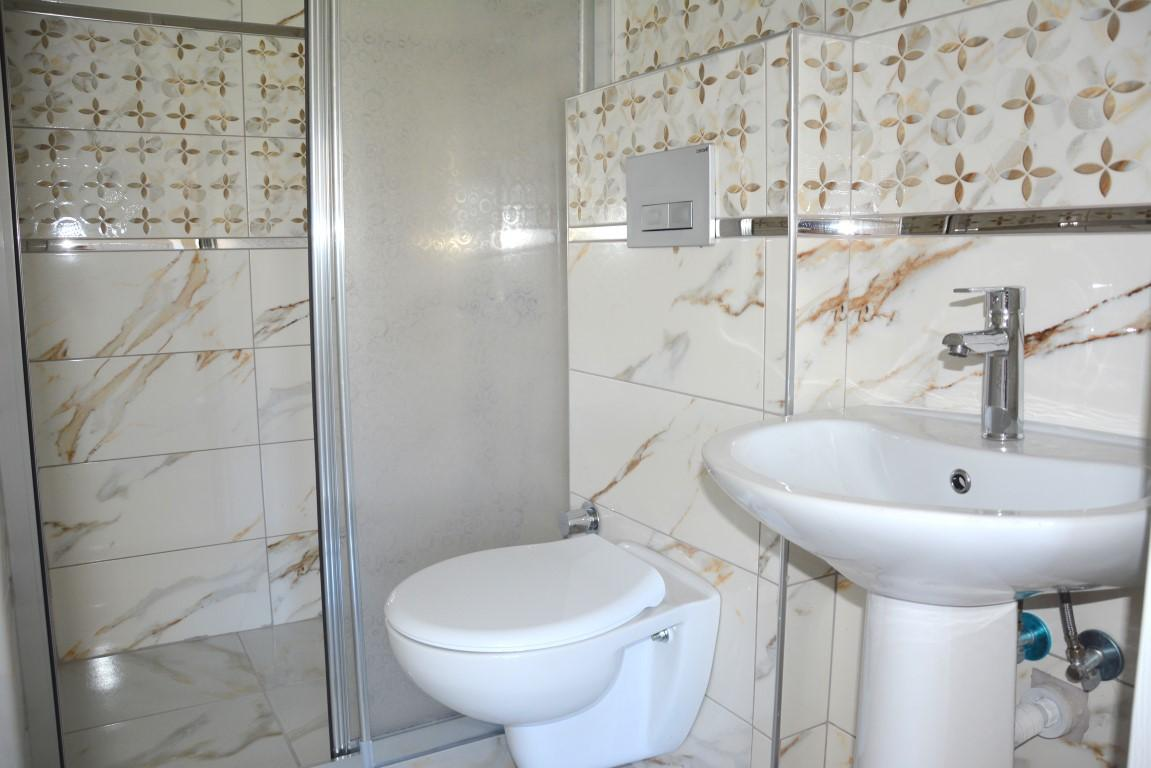 Новые просторные апартаменты 3+1 с панорамным видом в Махмутлар - Фото 25