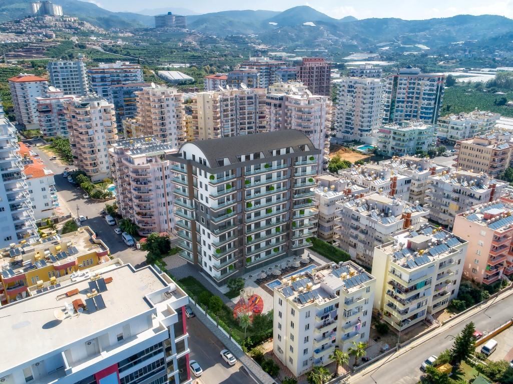 Новые квартиры в комплексе рядом с морем в Махмутларе - Фото 9