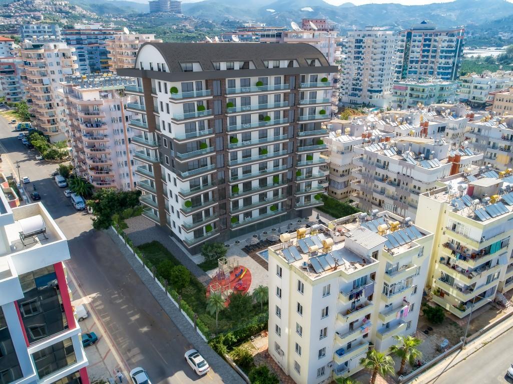 Новые квартиры в комплексе рядом с морем в Махмутларе - Фото 10