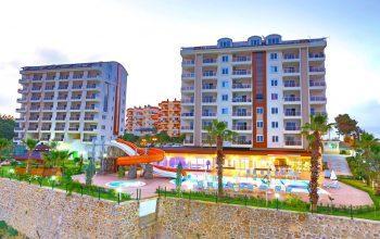 Двухуровневые апартаменты в супер комплексе в Авсалларе