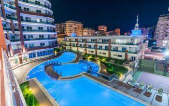Апартаменты 2+1 с инфраструктурой отеля 5 в Махмутлар