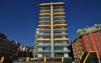 Новые  апартаменты 1+1 премиального класса на первой береговой линии в Махмутлар