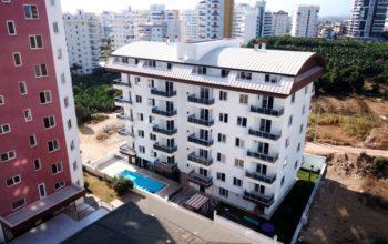 Новая квартира 1+1 в уютном комплексе в Махмутларе